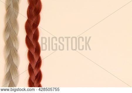 Beautiful Braids Are Braided By A Brown-haired Woman And A Blonde On A Delicate Background. The Conc