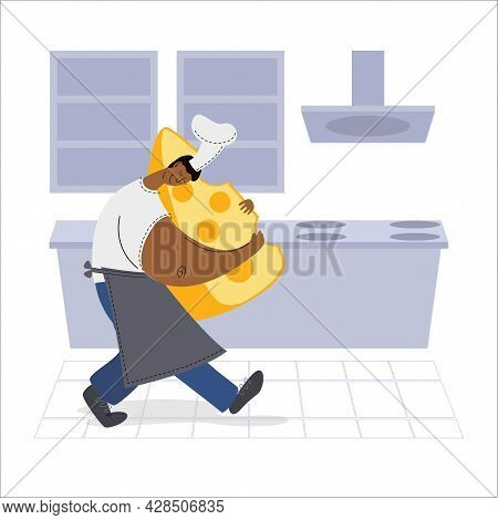 Dark Skinned Chef Holding A Piece Of Cheese In The Kitchen