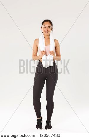 Sport, Gym And Healthy Body Concept. Full Length Of Smiling Cute Slim Girl, Fitness Trainer Or Sport
