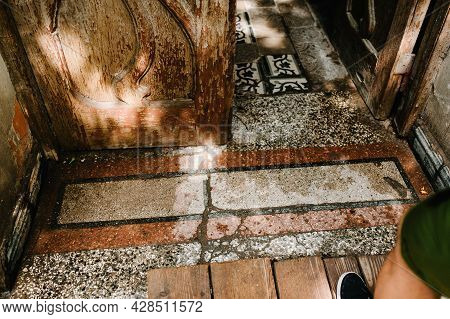 A Top View Of The Person Who Enters The Old House, With A Wooden Door And A Broken Stone Floor. Dila