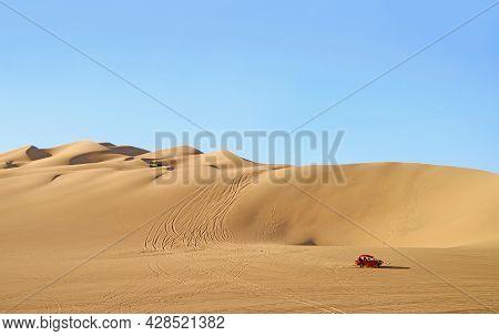 Dune Buggies Running On The Amazing Huacachina Sand Dunes In Ica Region, Peru, South America