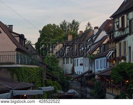 View On The River And Colorful Facades At Dusk In Colmar In France