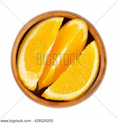 Orange Slices, In A Wooden Bowl. Fresh Cut Oranges, Sliced Ripe And Sweet Fruits With Yellow, And Ju