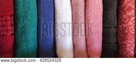 Top View Of Colored Towels. Body And Face Towels Stored And Organized In A Wooden Clothes Guard Draw