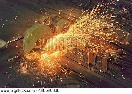 Sawing A Metal Channel With A Saw.