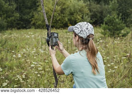 Young Woman Scientist Zoologist Sets Camera Trap For Observing Wild Animals In Forest To Collect Sci