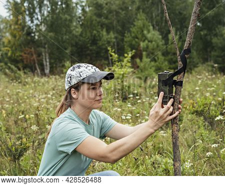 Young Woman Scientist Biologist Zoologist Sets Camera Trap For Observing Wild Animals In Summer Taig