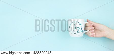 Business Button 24 Hours Service. Girl Hand Hold Morning Coffee Cup With Sign 24 Hour Icon On Blue B