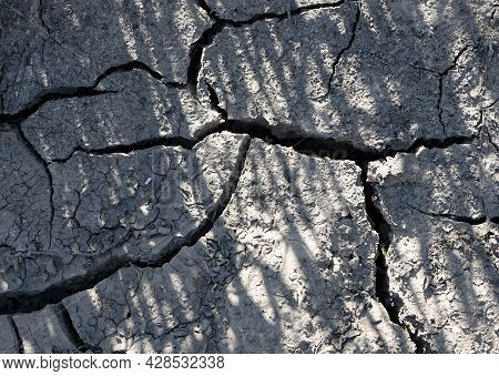 Cracked Earth, Cracked Soil. Texture Of Grungy Dry Cracking Parched Earth. Global Warming Effect. Cl
