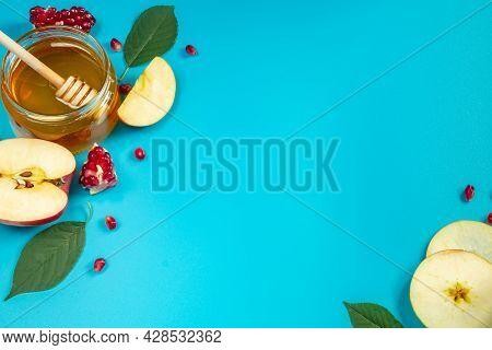 Honey, Apples And Pomegranates On A Blue Background. Happy Rosh Hashanah. Jewish Traditional Religio