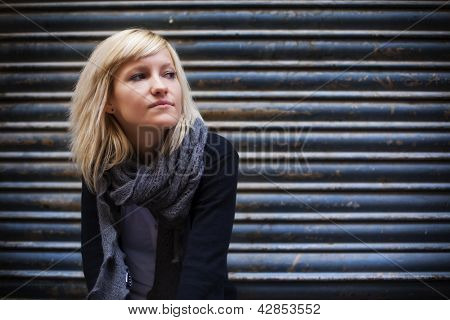 Young beautiful urban girl staring copy space.