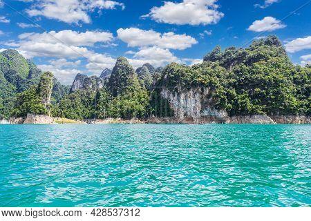 Lake With Mountains At Ratchaprapha Dam Or Khao Sok National Park, Surat Thani Province, Thailand