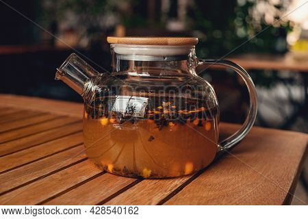 Tea With Sea Buckthorn In Glass Teapot In Cafe. Herbal Tea To Strengthen The Immune System - Image