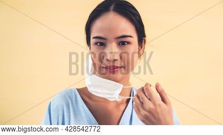 Young Asian Woman Take Off Face Mask Removing From Face Showing Concept Of The End Of Quarantine And