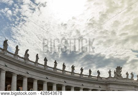 Details Of The Entablature With Statues Of Religious Saints On The Colonnades Of St. Peter's Basilic