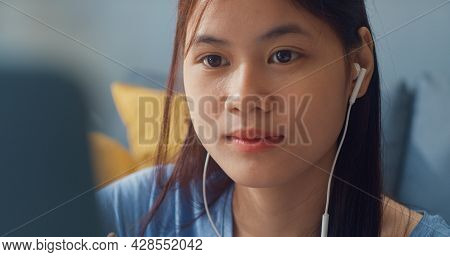 Young Asia Girl Teenager With Casual Wear Headphones Use Laptop Computer Learn Online Write Lecture