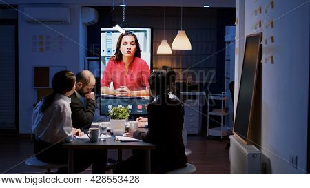 Workaholics Multi-ethnic Businesspeople Discussing Financial Strategy During Online Videocall Meetin