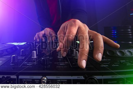 A Dj Hands On The Music Turntable.