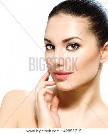 Beauty Woman Portrait. Beautiful Young Woman isolated on a White Background. Touching Her Face. Fresh Clean Skin.