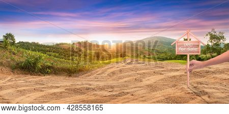 House Symbol And Land For Sale Signboard And Empty Dry Cracked Swamp Reclamation Soil, Land Plot For