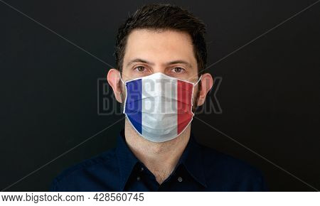 Man Wearing French Flag Protective Medical Face Mask. He Looks Worried And Concerned. Coronavirus Co