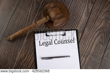 Legal Counsel Text On Paper With Gavel On Wooden Background