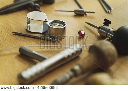 Various Jeweler Tools On The Wooden Table