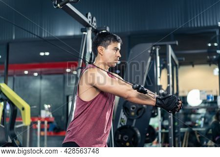 Caucasian Active Fitness Trainer Workout Exercise For Health In Gym. Attractive Strong Fit Bodybuild