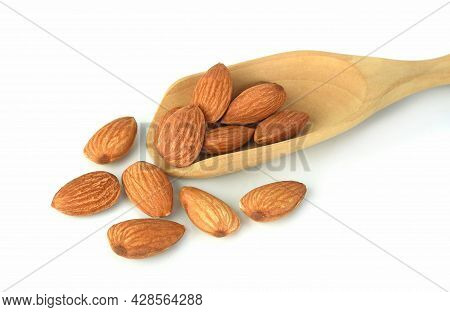 Almond And Almond In Wooden Spoon Isolated On White Background