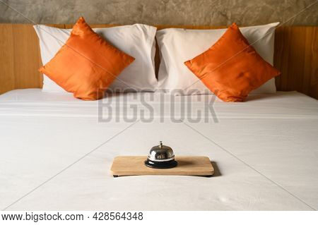 A Hotel Bell On The Bed In Hotel Bedroom. Hotel Bell Is Normally Use To Call Staff Service And Staff