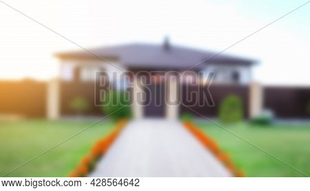 Blurred Abstract Background Of House In Summer.