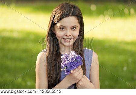 Summer Beauty Products. Happy Kid Hold Summer Flowers. Beauty Salon. Floral Shop. Summer Holidays An