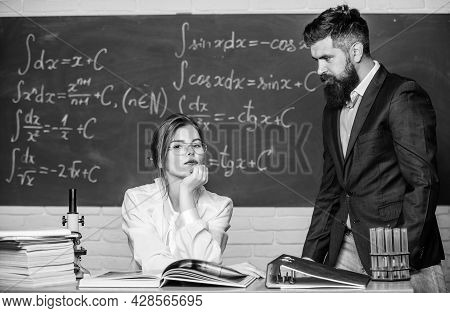 Education And Training. Couple In School For Adult Education. Sexy Education Worker And Bearded Man.