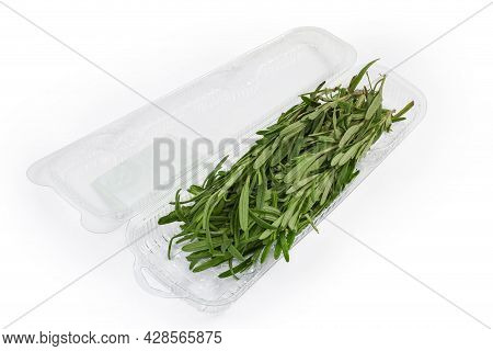 Fresh Rosemary Stems In An Open Transparent Plastic Container On A White Background