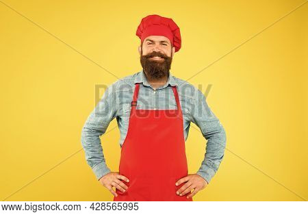 Mature Male Chef On Yellow Backdrop. Man Cooking On Kitchen. Professional Chef Man Excited And Smili