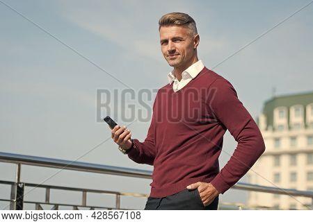 Managing Business In Real Time. Businessman Text Sms Via Smartphone. Handsome Man Arrange Business M