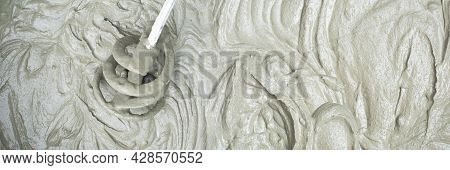 Concrete Mixing With Electrical Drill And Mixer. Panoramic Banner Cement Mortar Texture Background