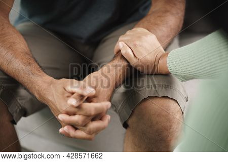 Female Friend Or Family Sitting And Hold Hands During Cheer Up To Mental Depress Man, Psychologist P