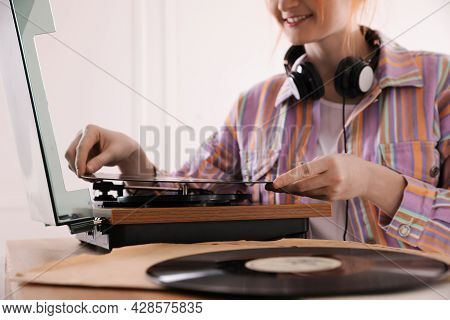Young Woman Using Turntable At Home, Closeup