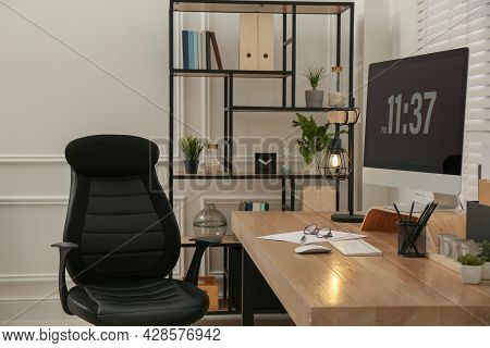 Home Office Interior With Comfortable Workplace Near Window