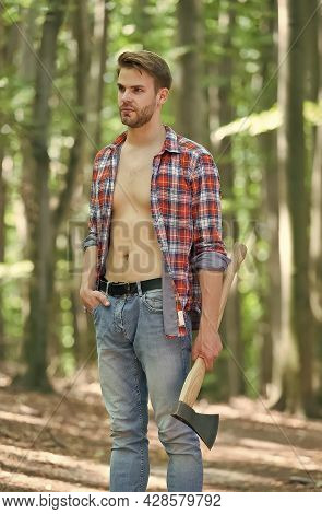 Every Man Needs Some Time For Himself. Handsome Guy Hold Axe In Woods. Unshaven Guy With Sexy Torso