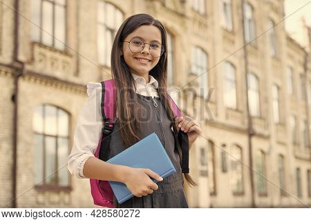 Learn Well Today. Happy Kid In Glasses Carry Book And Backpack. Back To School Essentials. School Li
