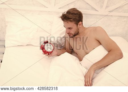 Man Sleeping Bed White Bedclothes And Red Alarm Clock, Time To Wake Up Concept