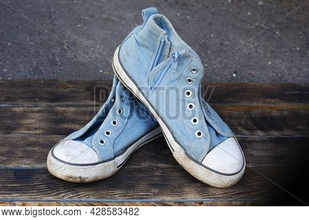 Pair Old Dirty Blue Sneakers On Wooden Background