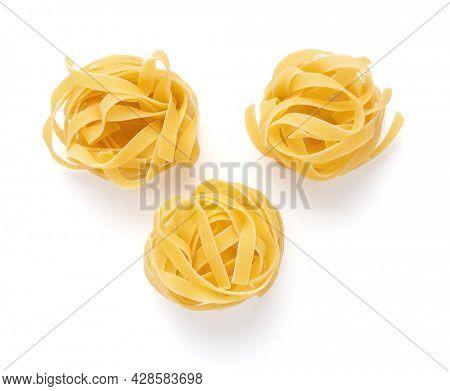 Pasta tagliatelle isolated on white background. Raw tagliatelle italian food at white