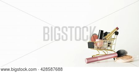 Shopping Trolley Full Of Make Up And Cosmetic Goods On White Background. Black Friday Concept. Sale