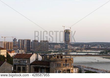 Belgrade, Serbia -  July 27, 2021: View Of Belgrade Old Buildings And Belgrade Waterfront Luxury Res