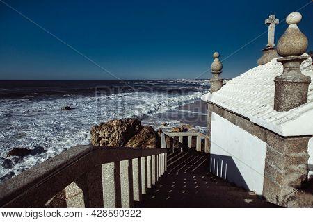 View of the Atlantic Ocean from Chapel Senhor da Pedra on Praia de Miramar, Vila Nova de Gaia, Portugal.