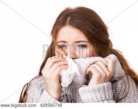 Sick Freezing Woman Sneezing In Tissue. Girl Wearing Warm Sweater Being Cold And Trembling. Flu Or O