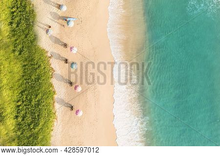 Aerial Drone Top View Crowd Of Happy People Relax At Tropical Beach With Sunset In Phuket, Thailand,